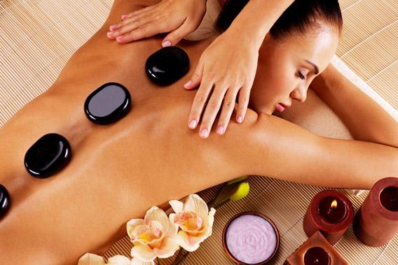 Massagem nas costas + pedras quentes
